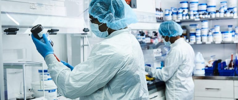 Pharmacists in sterile compounding lab