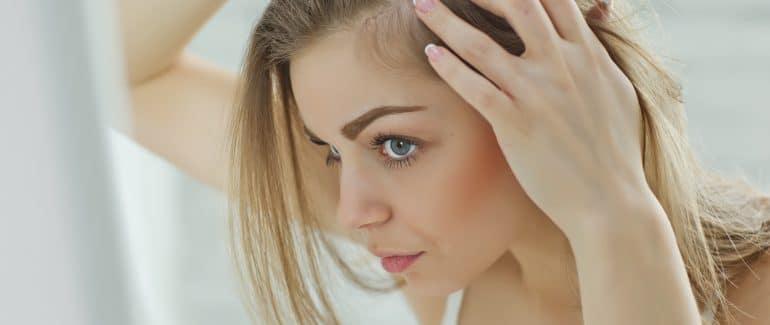 Woman looking at hair loss