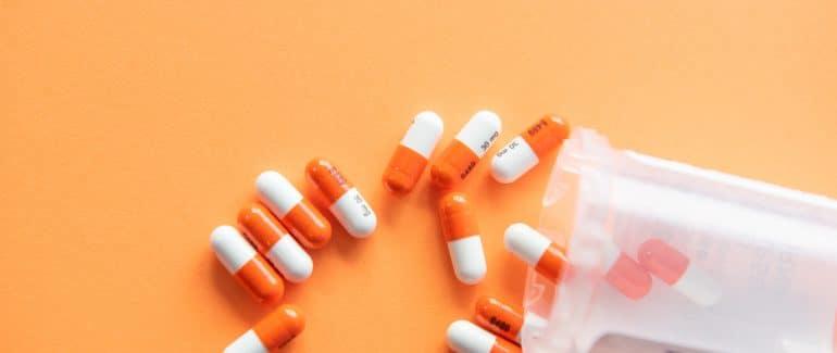 white and orange pills